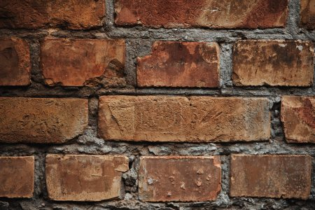 full frame image of old brick wall with cement background