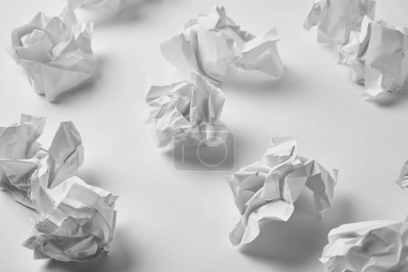 Photo for Close-up shot of messy crumpled papers on white surface - Royalty Free Image