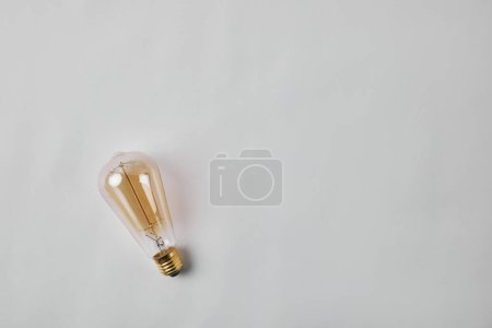 top view of vintage incandescent lamp on white surface