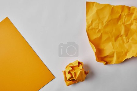 Photo for Top view of yellow papers on white surface - Royalty Free Image
