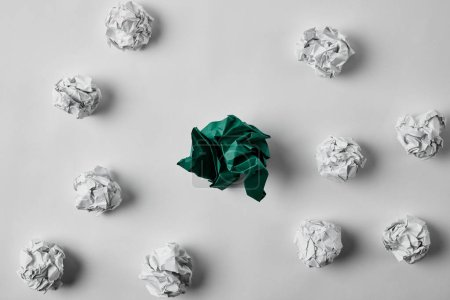 Photo for Top view of green and white crumpled papers on white surface - Royalty Free Image