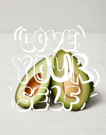 "fresh green avocado, clean eating concept. ""Love your self"" inspiration"