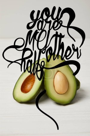 """fresh green avocado, clean eating concept. """"You are my other half"""" lettering"""