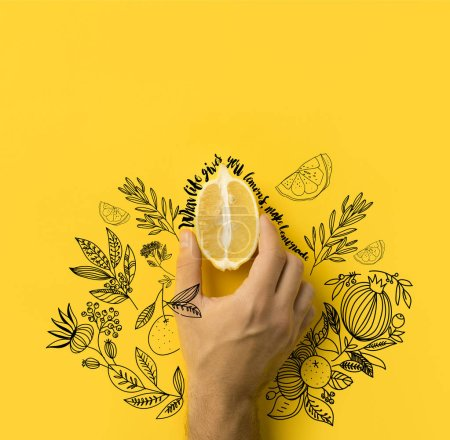 "man holding half of lemon isolated on yellow with ""when life gives you lemons, make lemonade"" lettering and floral illustration"