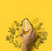 """man holding half of lemon isolated on yellow with """"when life gives you lemons, make lemonade"""" lettering and floral illustration"""
