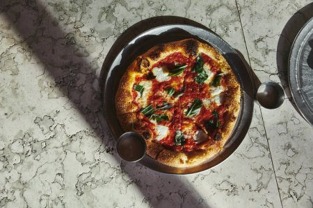 top view of delicious pizza margherita on marble tabletop