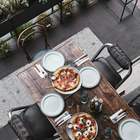 Photo for Top view of different delicious pizza on trays at restaurant - Royalty Free Image