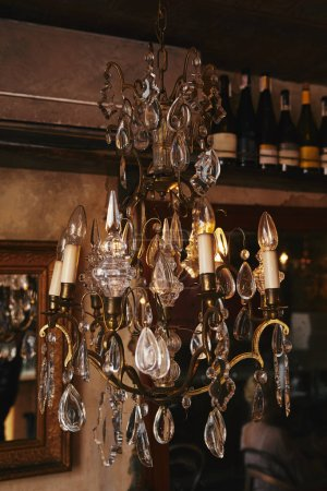 close-up shot of luxury chandelier hanging from ceiling of restaurant