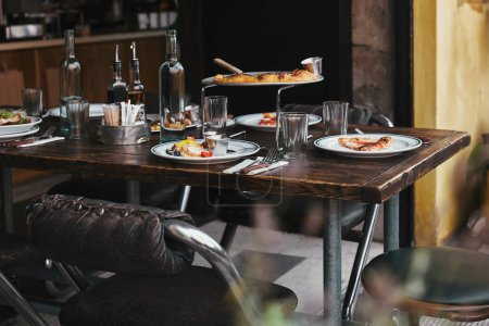 Photo for Delicious italian meal on rustic table at luxury restaurant - Royalty Free Image