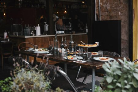 italian meal on rustic table at modern restaurant