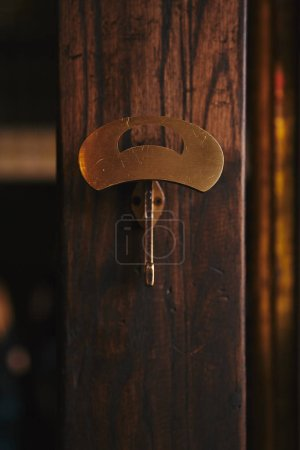 Photo for Close-up shot of clothes hanger on wooden wall - Royalty Free Image