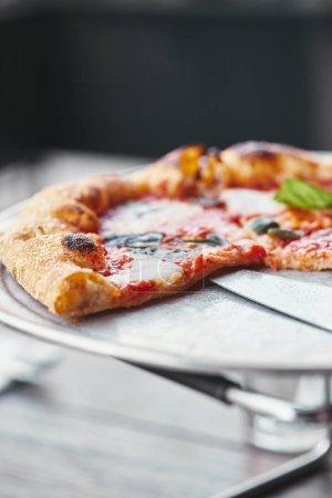 close-up shot of freshly baked pizza margherita on tray