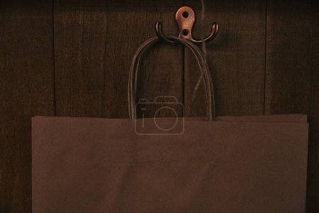close-up shot of blank paper bag hanging on wooden wall