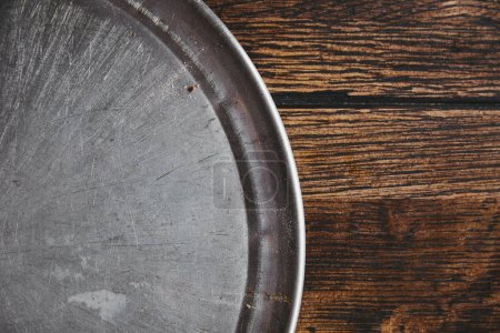 top view of empty metal kitchen tray on rustic wooden table