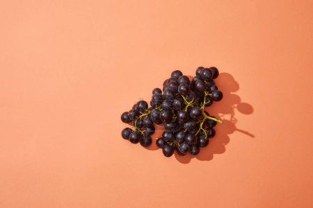 bunch of fresh ripe sweet grapes on red background