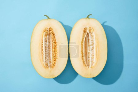 top view of fresh ripe sweet halved melon on blue