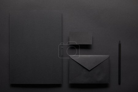 Black mock up composition with notebook and card on black background