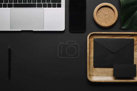 Photo for Digital devices and office supplies on black background - Royalty Free Image