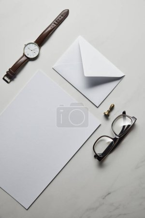 Business mock up set with glasses and watch on white marble background