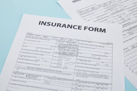 close-up view of insurance form on blue, insurance concept