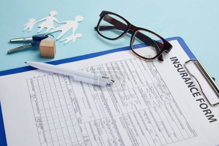 insurance form, eyeglasses, pen, paper cut family and keys isolated on blue
