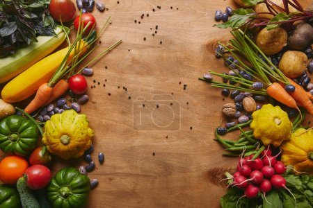 Photo for Frame of healthy food vegetables and beans on wooden table - Royalty Free Image