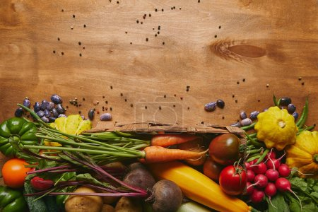 Whole food template with fresh vegetables on wooden table