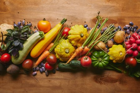 Food composition with vegetables and beans on wooden table
