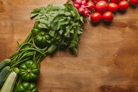 Photo for Green and red summer vegetables on wooden table - Royalty Free Image