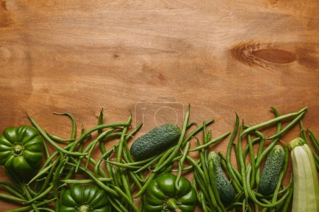 Green beans and organic vegetables on wooden table