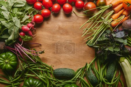 Photo for Frame of healthy green and red vegetables on wooden table - Royalty Free Image