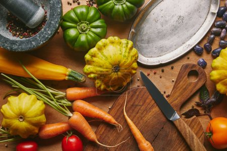 Vegetables and cooking utensils on wooden table