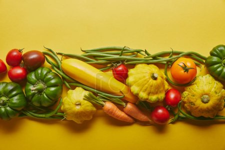 Bright wholesome vegetables on yellow background