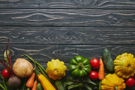 Food composition with colorful vegetables on dark wooden table