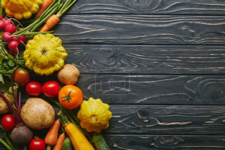 Photo for Whole fresh vegetables on dark wooden table - Royalty Free Image