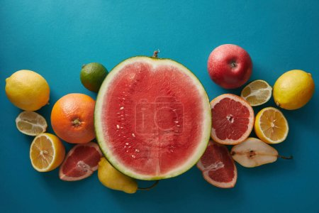Photo for Top view of watermelon, grapefruits and lemons on blue surface - Royalty Free Image