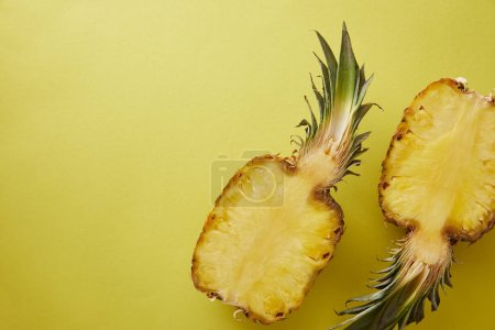 top view of cut pineapple on yellow surface