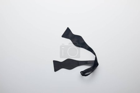 top view of untied black bow tie isolated on white
