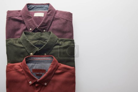 flat lay of three colored shirts isolated on white