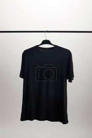 one black shirt on hanger isolated on white