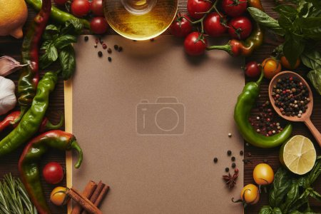 top view of blank menu and fresh vegetables, spices and herbs on wooden surface