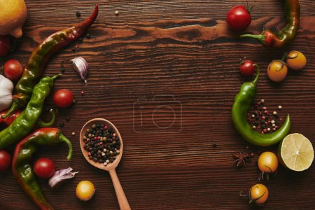 Photo for Top view of wooden spoon with peppercorns and ripe healthy vegetables - Royalty Free Image