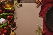 top view of blank card, spices and vegetables on wooden surface