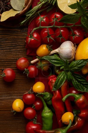 top view of fresh ripe healthy vegetables on wooden surface
