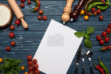 top view of blank menu template, fresh vegetables, cutlery and spices on wooden surface