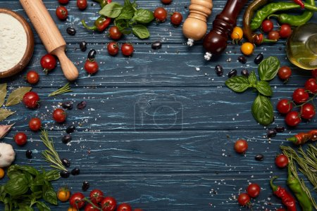 fresh raw vegetables, spices and rolling pin on wooden background