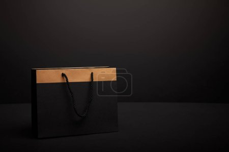 Photo for Close up view of paper shopping bag on black backdrop - Royalty Free Image