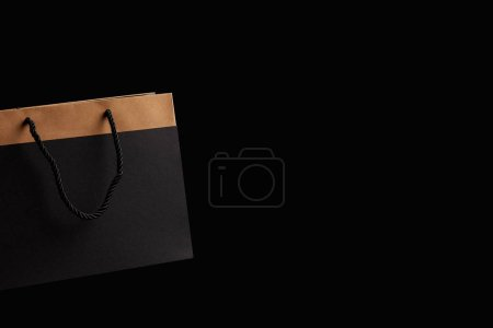 Photo for Close up view of paper shopping bag isolated on black - Royalty Free Image