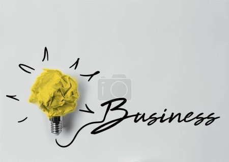 top view of crumpled paper as light bulb with business lettering