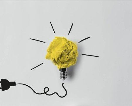 Photo for Top view of crumpled paper as light bulb with drawn plug - Royalty Free Image